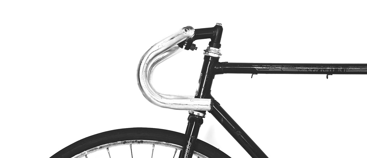 Black bicycle agains a white background
