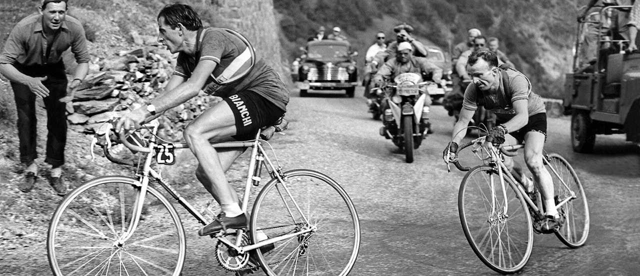 Fausto Coppi and Jean Robic ride up Alpe d'Huez in the 1952 Tour de France