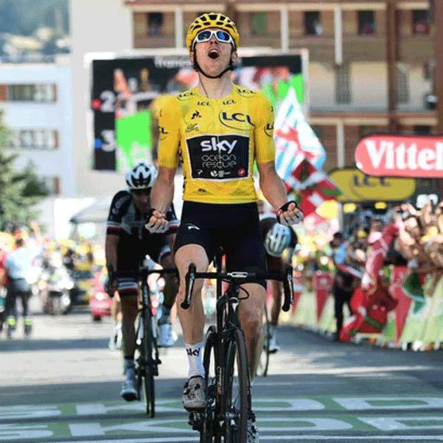 Gerain Thomas celebrates his victory atop Alpe d'Huez in the 2018 Tour de France.