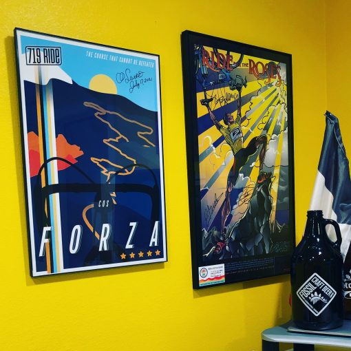 Framed 719 Ride poster designed by Hannah Unger and displayed on a yellow wall